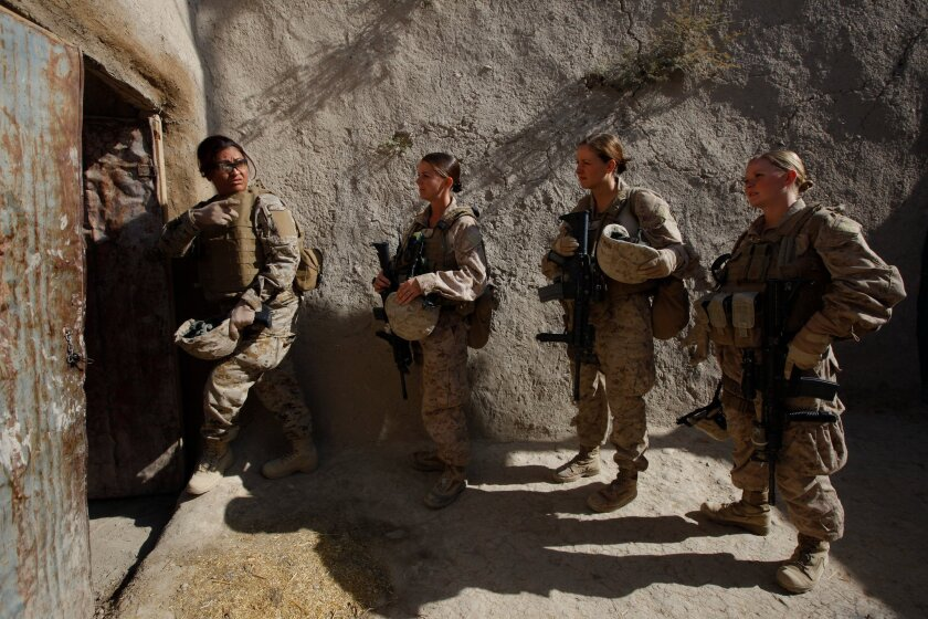 A Camp Pendleton Female Engagement Team at work in Afghanistan, including (from left) a linguist, Sgt. Sheena Adams, Navy hospital corpsman Shannon Crowley, and then-Lance Cpl. Kristi Baker.