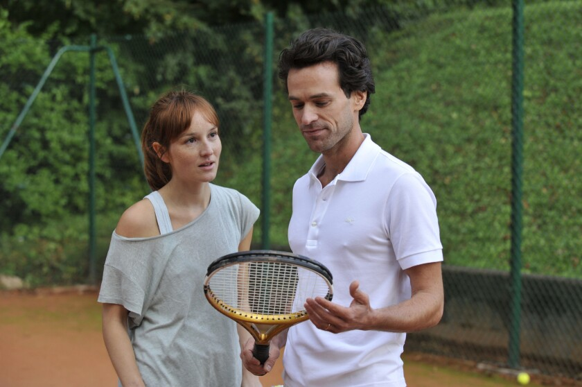 """Anais Demoustier and Romain Duris in the movie """"The New Girlfriend."""""""