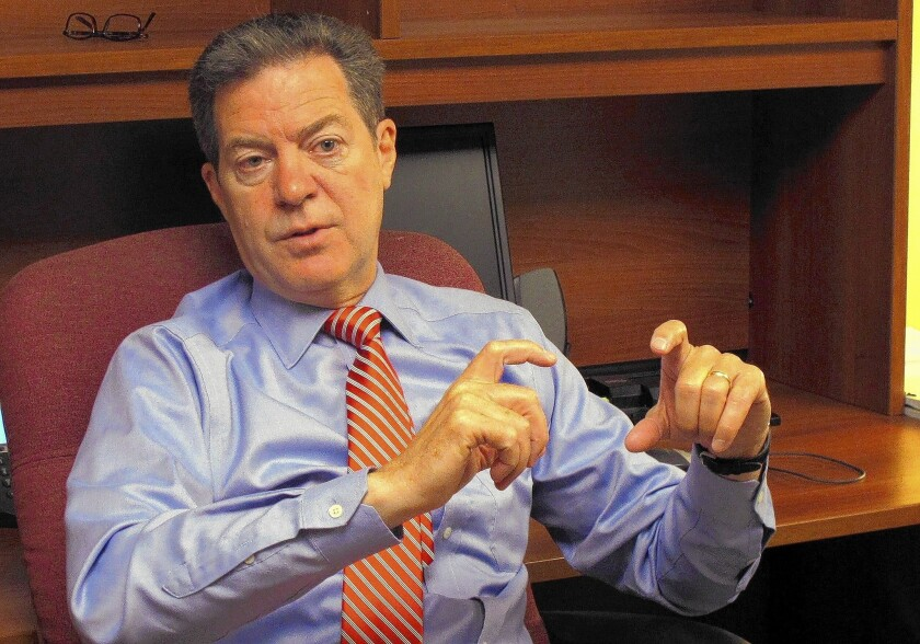 Kansas Gov. Sam Brownback, a Republican, is under pressure over controversial tax cuts he advocated.