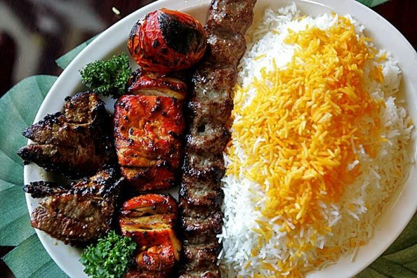 A combo dish with a boneless chicken kebab, one strip of charbroiled ground beef and two pieces of charbroiled lamb chop at House of Kabob in Lake Forest.
