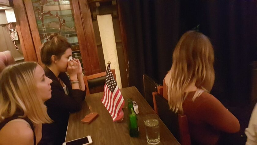 Alexandra Baker, 28, cries as she watches Donald Trump's first speech as president-elect from Legion Americana bar in Mexico City