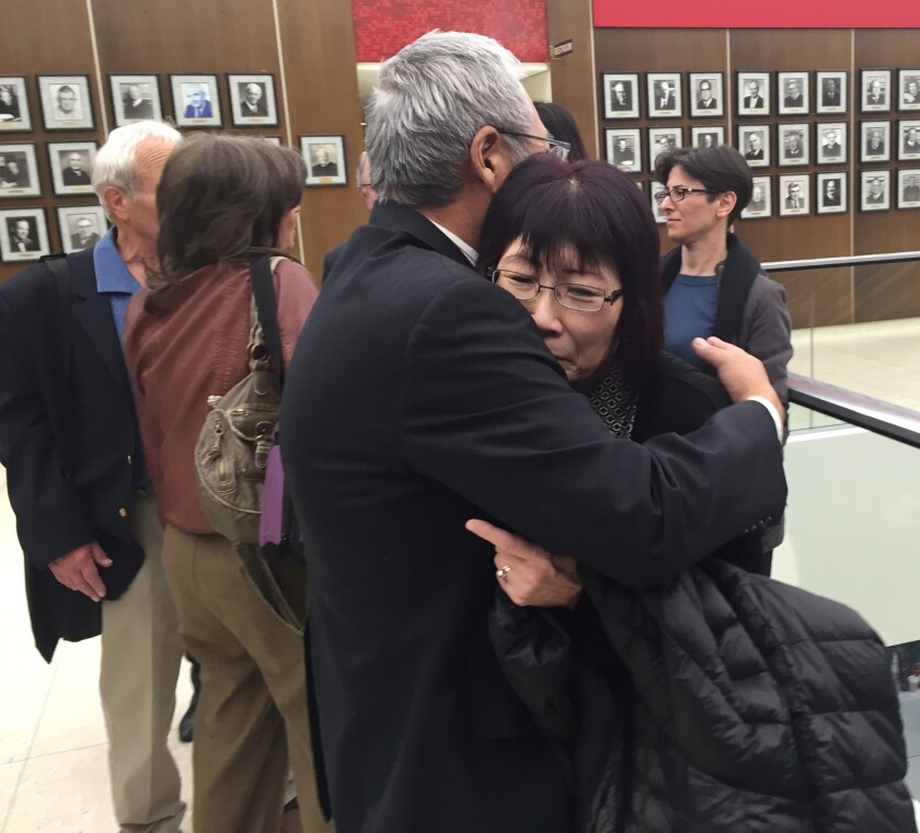 """Masa and June Kibuishi embrace outside an Orange County courtroom Monday after a jury recommended the death penalty for the man convicted of murdering their 23-year-old daughter, Juri """"Julie"""" Kibuishi, in May 2010."""