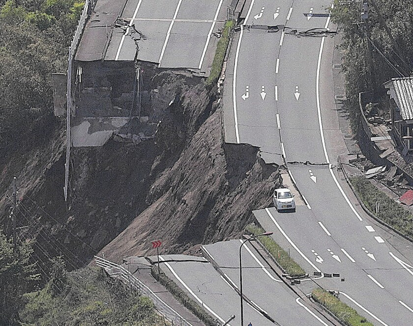 A road is severed after one of the earthquakes in Minamiaso, Japan.