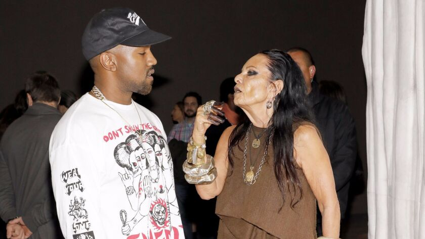 """Kanye West talks with Michèle Lamy at the opening party for the Museum of Contemporary Art exhibition """"Rick Owens: Furniture."""""""