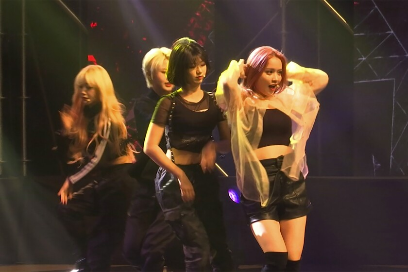 """In this image made from a video, former and current members of K-pop band """"Girls Alert"""" perform for end-of-year concert at Nowon district residential center in Seoul on Nov. 22, 2019. While popular K-pop bands like BTS and Blackpink have gone from strength to strength during the coronavirus pandemic, lesser-known acts are struggling. (AP Photo/Park Juwon)"""