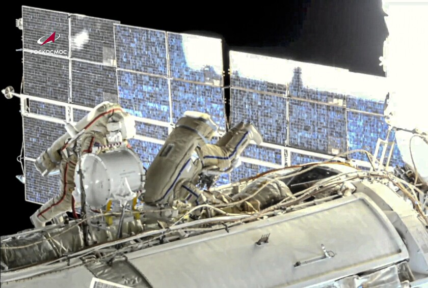 In this image taken from Roscosmos video, Russian cosmonauts Oleg Novitsky, left, and Pyotr Dubrov, members of the crew to the International Space Station (ISS), perform their first spacewalk on Wednesday, June 2, 2021, to replace old batteries outside the International Space Station. Two Russian members of the International Space Station crew are conducting a spacewalk. Oleg Novitskiy and Pyotr Dubrov are scheduled to conduct technical works before the arrival of a new Russian module. The duo is set to prepare for undocking and disposal of the Pirs docking compartment, which will be replaced later this year by the new Nauka (Science) multipurpose laboratory module. (Roscosmos via AP)