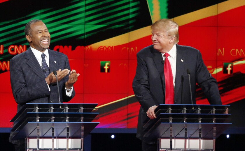 Ben Carson, left, and Donald Trump at the Republican presidential debate at the Venetian in Las Vegas.