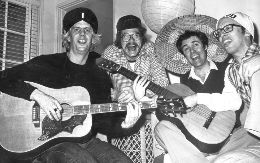 Phil Austin, left, who was a founding member of Firesign Theatre, seen Feb. 21, 1980, with David Ossman, Philip Proctor and Peter Bergman, has died at 74.