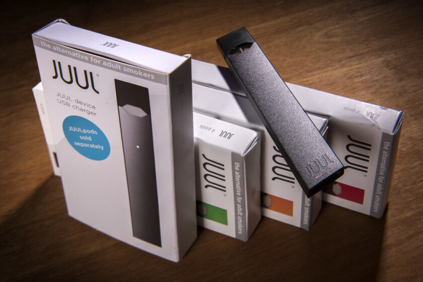 A Juul vaping system with accessory pods.