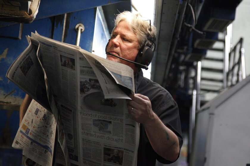 June 13, 2015 - San Diego, CA, U.S. - The final scheduled press run of the San Diego Union-Tribune goes through the presses Saturday night, ending an era. Ron Seneff checks the quality of reproduction on the last Union-Tribune scheduled to roll off the presses in Mission Valley.  San Diego Union-Tr