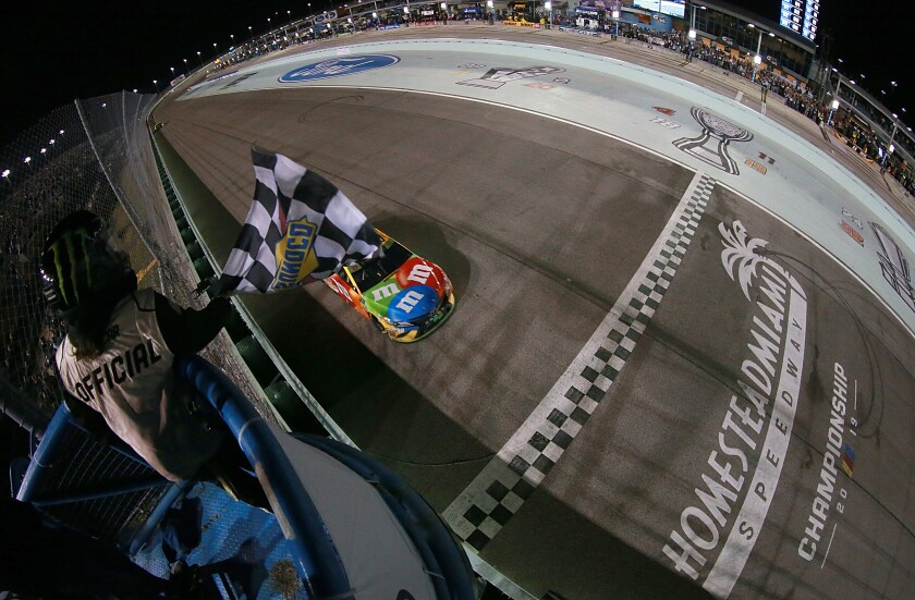 Kyle Busch crosses the finish line to win Sunday's NASCAR Cup race at Homestead Speedway.