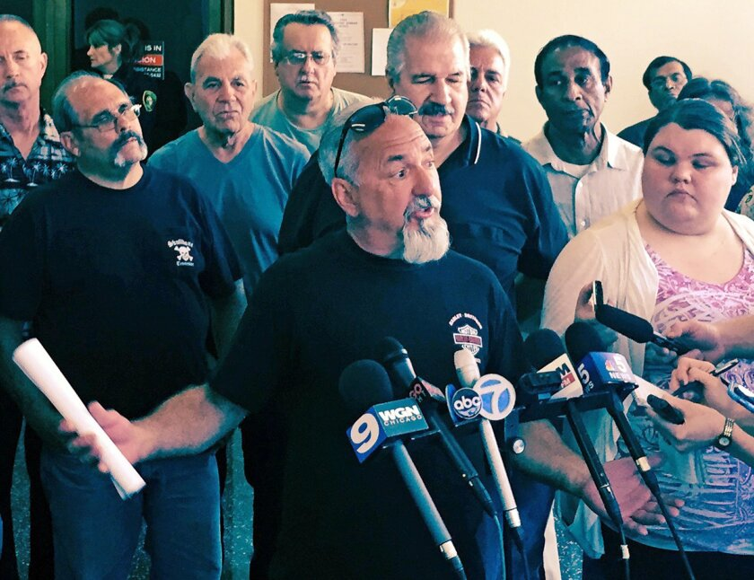 Charles Lomanto, a 28 year employee of Chicago's Streets and Sanitation Department speaks at a news conference Friday, July 24, 2015, in Chicago after Cook County Judge Rita Novak issued a written ruling stating that a 2014 law aimed at reducing multibillion-dollar shortfalls in two of Chicago's pension funds is unconstitutional. Mayor Rahm Emanuel has argued that without the changes the funds will be insolvent in a matter of years. (AP Photo/Sara Burnett)