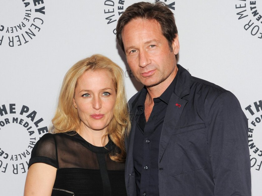 """FILE - In this Oct. 12, 2013 file photo, actors Gillian Anderson and David Duchovny attend """"The Truth Is Here: David Duchovny and Gillian Anderson on The X-Files"""" at The Paley Center for Media, in New York. Fox announced on March 24, 2015, that it will air a six-episode run of new episodes of """"The X-Files"""" that will begin this summer. Stars Duchovny and Anderson will reprise their roles as FBI agents Fox Mulder and Dana Scully. (Photo by Evan Agostini/Invision/AP, File)"""