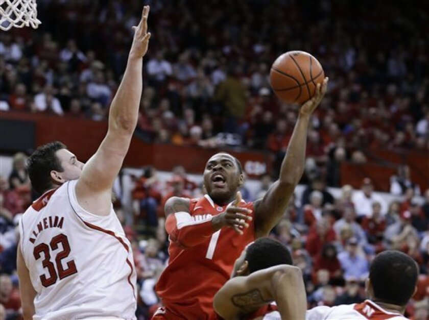 Ohio State's Deshaun Thomas (1) shoots over Nebraska's Andre Almeida (32) during the first half of an NCAA college basketball game in Lincoln, Neb., Saturday, Feb. 2, 2013. (AP Photo/Nati Harnik)