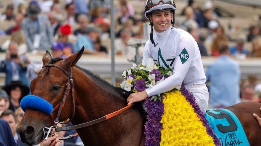 Jockey Flavien Prat and Battle of Midway in the winner's circle after they won the Breeders' Cup Dirt Mile on Nov. 3 at Del Mar.