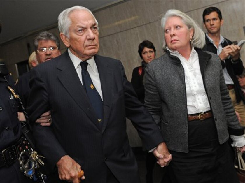 Anthony Marshall and wife Charlene exit the courtroom following the verdict at Manhattan State Supreme Court,Thursday, Oct. 8, 2009, in New York.Marshall, Brooke Astor's 85-year-old son was convicted Thursday of exploiting his philanthropist mother's failing mind and helping himself to her nearly $200 million fortune. (AP Photo/ Louis Lanzano)