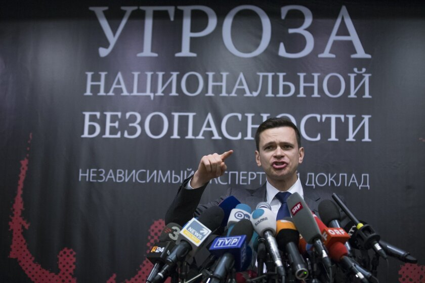 Russian opposition activist Ilya Yashin gesture as he speaks while presenting a report on Chechen leader Ramzan Kadyrov, in Moscow, Tuesday, Feb. 23, 2016. Yashin released a report accusing Moscow-backed Chechnya's regional leader, Ramzan Kadyrov, of involvement in the killing of Russian opposition leader Boris Nemtsov and other alleged crimes. (AP Photo/Alexander Zemlianichenko )