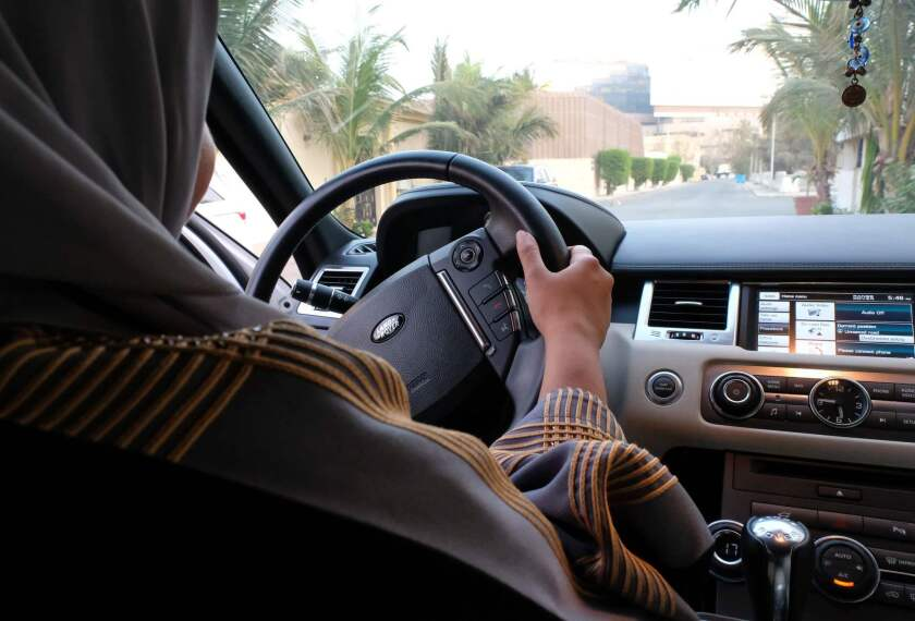 A Saudi Arabian woman drives her car along a street in the coastal city of Jidda