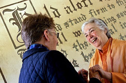 Sudha Puri Devi, right, the swamini of the Temple of the Universal Spirit in La Crescenta, greets Sister Linda Snow from Encino. The compound is dedicated to Vedanta, a Hindu philosophy that honors all of the world's religions.
