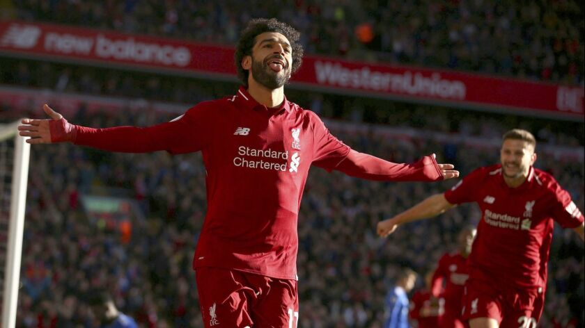Liverpool's Mohamed Salah celebrates scoring his side's first goal of the game, during the English P