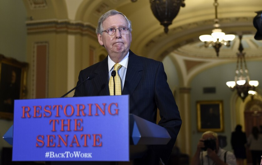 Senate Majority Leader Mitch McConnell (R-Ky.) speaks to reporters on Capitol Hill in Washington on Thursday.
