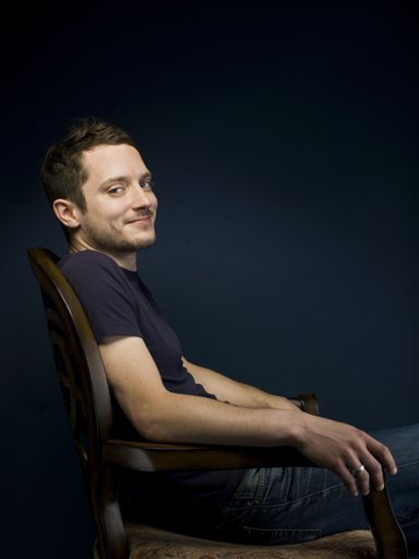 """In this Friday, June 24, 2011 photo, Elijah Wood poses for a portrait in New York.  Wood stars in the new FX series """"Wilfred."""" (AP Photo/Victoria Will)"""