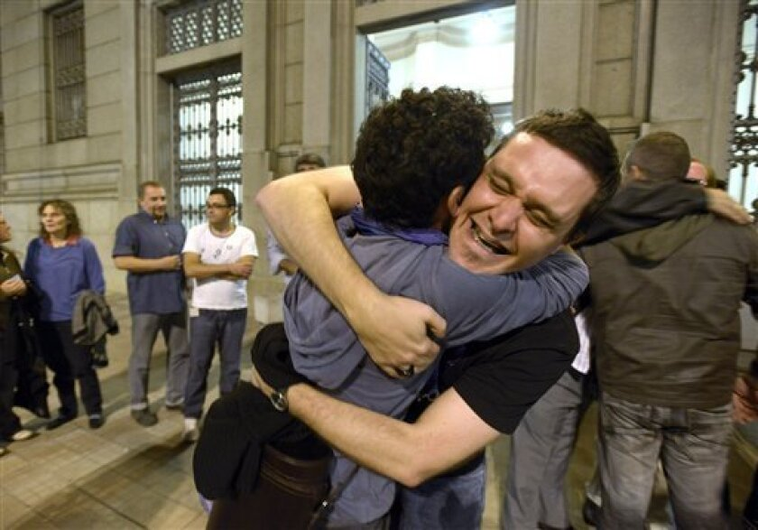 """People celebrate outside the Parliament after lawmakers passed the """"marriage equality project"""" in Montevideo, Uruguay,Wednesday, April 10, 2013. Their vote makes Uruguay the third country in the Americas after Canada and Argentina to eliminate laws making marriage, adoption and other family rights"""