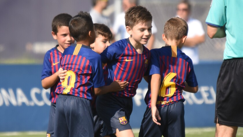 a67059ffb5e189 FC Barcelona's youth academy searches for soccer's next Messi - Los ...