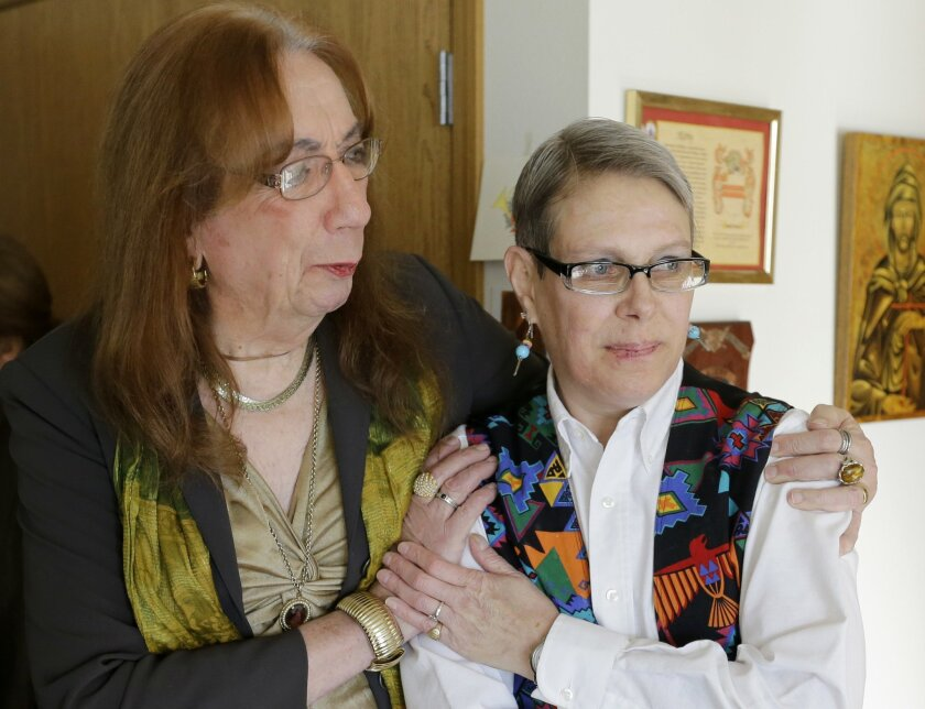 """This Dec. 12, 2013 photo shows Barbara Satin, a 79-year-old transgender activist described by building residents as """"the matriarch of Spirit on Lake,"""" left, with resident Lucretia Kirby in her unit at Spirit on Lake in Minneapolis. (AP Photo/Ann Heisenfelt)"""