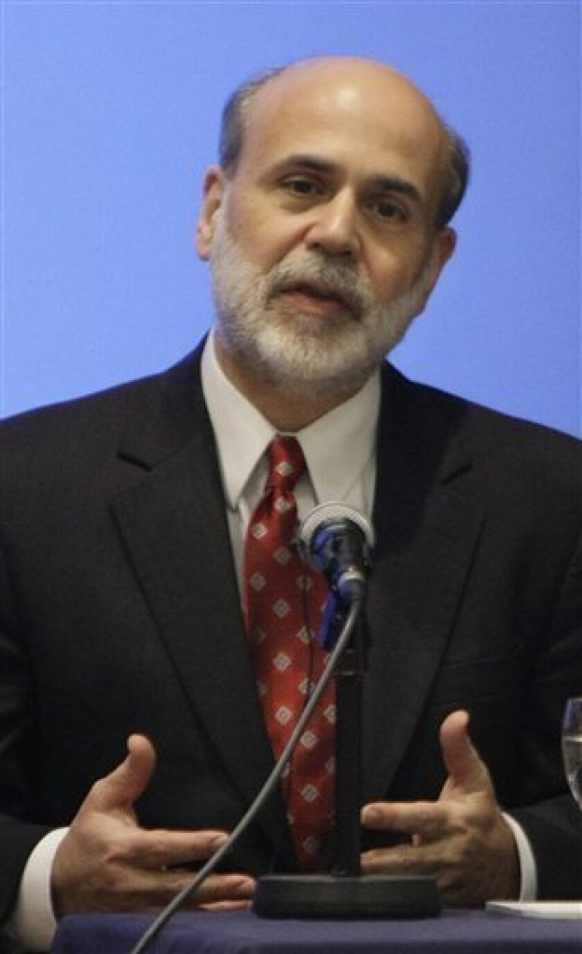 "U.S. Federal Reserve chairman Ben Bernanke delivers a speech to the London School of Economics in London, Tuesday Jan. 13, 2009.  Bernanke said Tuesday the stimulus package being crafted by President-elect Barack Obama and Congress could provide a ""significant boost"" to the sinking economy. But he"