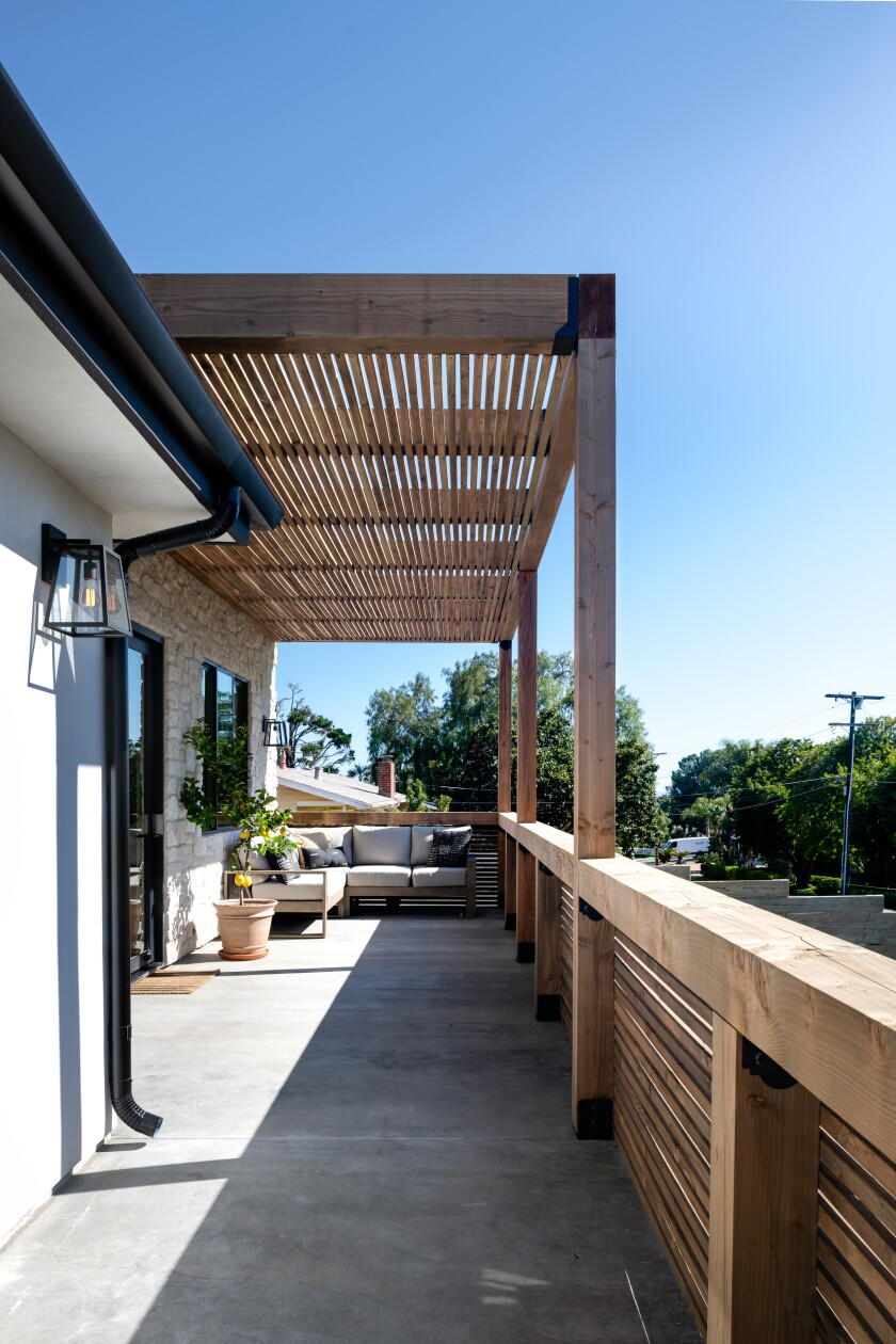 The front porch features a trellis like one former homeowner Shirley Slee saw in Mexico, a sitting area and an ocean view.
