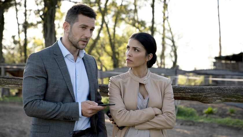 """Luke Roberts and Nazneen Contractor in """"Ransom"""" on CBS."""