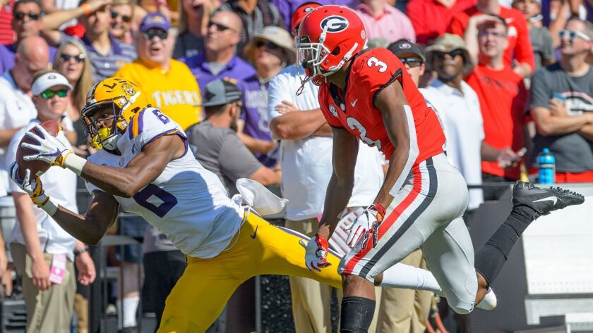 LSU wide receiver Terrace Marshall Jr. (6) makes a reception against Georgia defensive back Tyson Ca