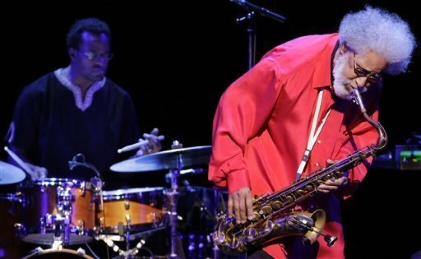 In this Oct. 4, 2010 photo, jazz great Sonny Rollins plays his tune during his concert in Tokyo. Rollins is back this week on an 80th birthday tour in this nation long known for its love of jazz. (AP Photo/Junji Kurokawa)