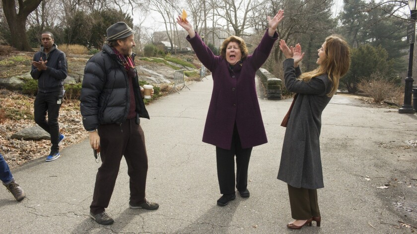 "Director Stefan Schwartz, Margo Martindale and Keri Russell on the set of ""The Americans."""