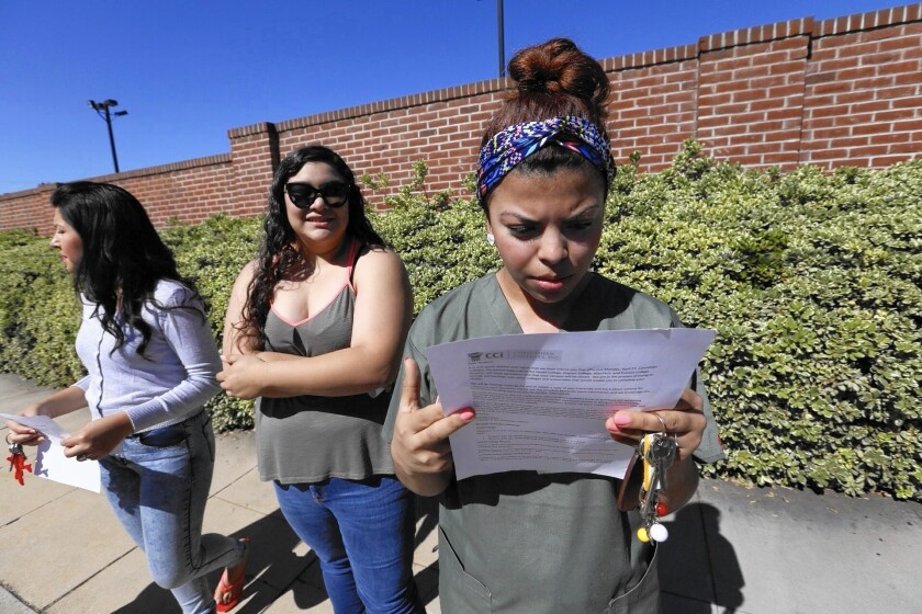 Ruby Maldanado, 20, a student at Everest College in Alhambra, reads a notice about the school's closure.