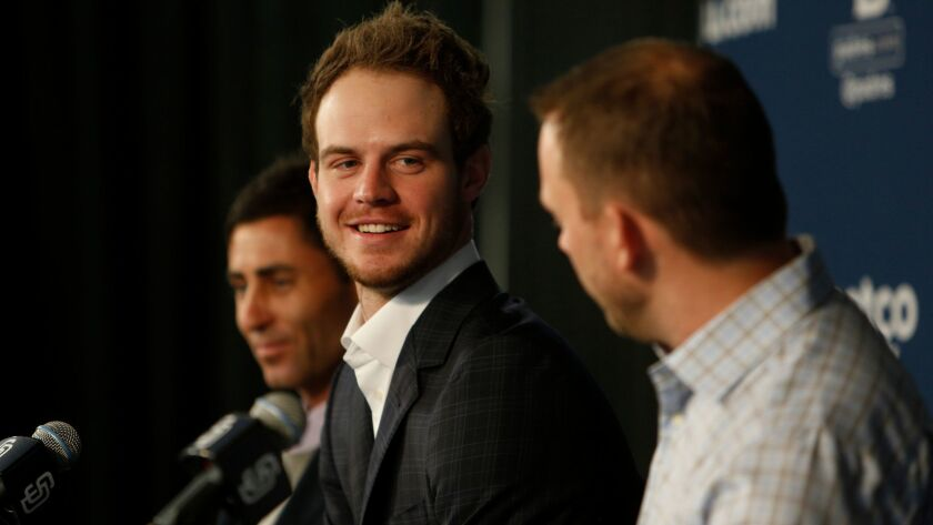 Flanked by General Manager A.J Preller, left, and manager Andy Green, right, Padres first baseman Wil Myers, center, was all smiles during a press conference to officially announce his six year, $83 million extension.