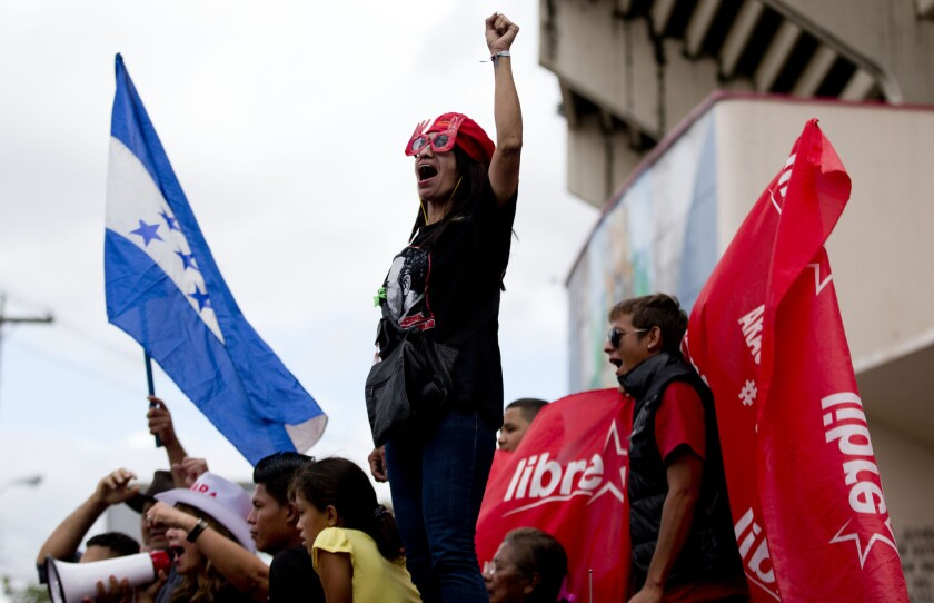 A supporter of Free Party presidential candidate Xiomara Castro shouts slogans during a protest against election results in Tegucigalpa, Honduras.