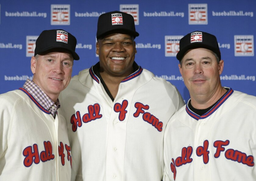 Former Atlanta Braves pitchers Tom Glavine, left and Greg Maddux, right, pose with Chicago White Sox slugger Frank Thomas after a press conference announcing their election to the 2014 Baseball Hall of Fame class, Thursday, Jan. 9, 2014, in New York. The trio will be inducted into the Hall of Fame