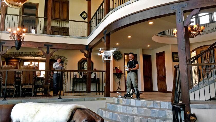 Adrian Zaw of Zaw Studios operates a drone inside a $3.885-million Big Bear home for sale.