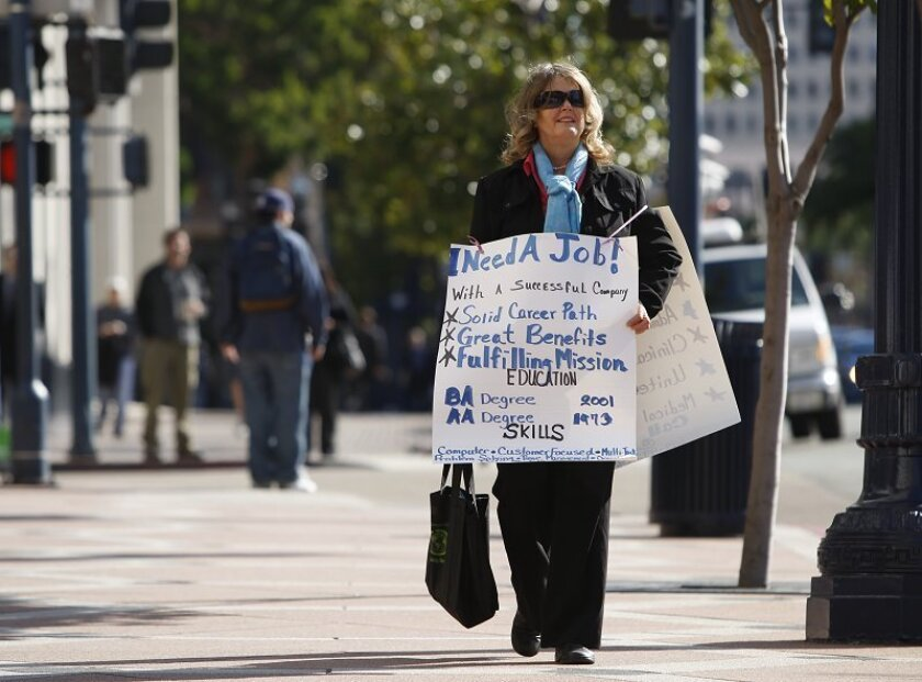 Rita Thompson woke up Tuesday, got a stack of  résumés together and hit the pavement in downtown San Diego.  But unlike other job seekers, Thompson, 57, was hoping the employers would come  to her. Résumés at the ready, she walked along Broadway for about seven hours  wearing a