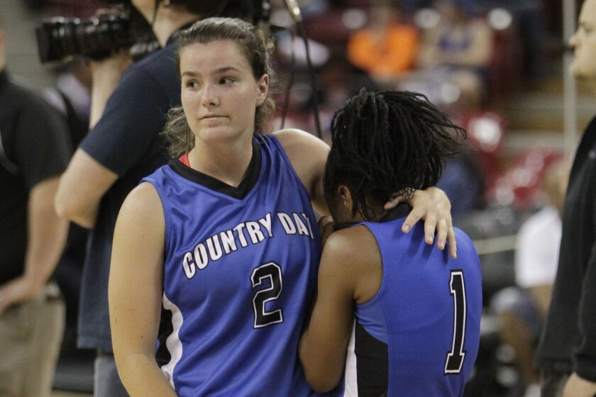 La Jolla Country Day's Taylor Johnson (left) comforts teammate Hadiyah Muhammad after the Torreys were defeated in the State Division V championship game in Sacramento.
