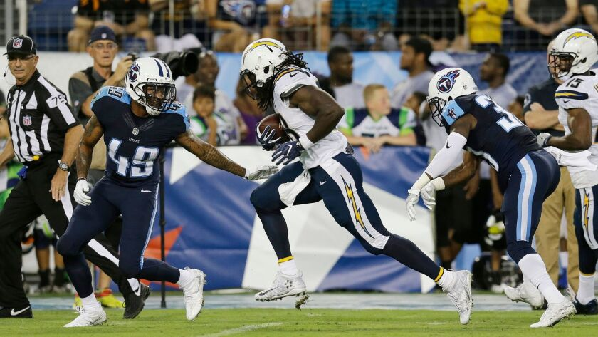 The Chargers' Melvin Gordon runs toward the end zone against Tennessee's Alex Ellis (49) and David Fluellen on Aug. 13, 2016.