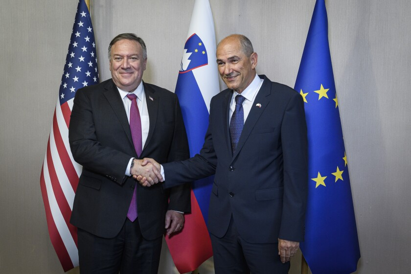 Slovenian Prime Minister Janez Jansa, right, shakes hands with US Secretary of State Mike Pompeo ahead of their meeting in Bled, Slovenia, Thursday, Aug. 13, 2020. Pompeo is on a five-day visit to central Europe with a hefty agenda including China's role in 5G network construction. (Jure Makovec/Pool Photo via AP)