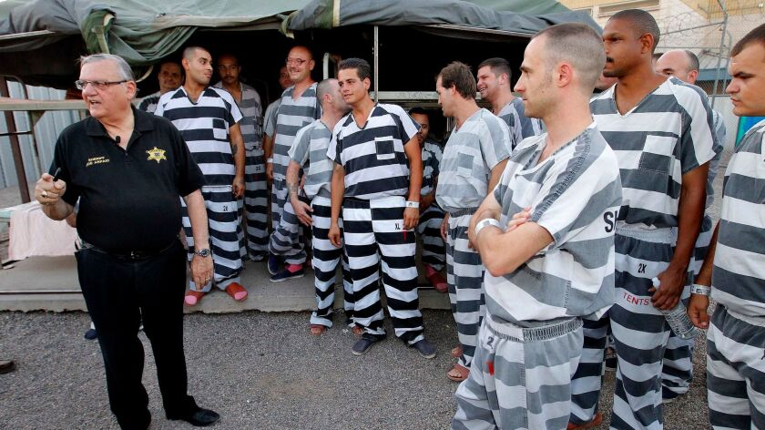 "Inmates gather around Sheriff Joe Arpaio as he walks through a Maricopa County jail called ""Tent City"" in Phoenix."