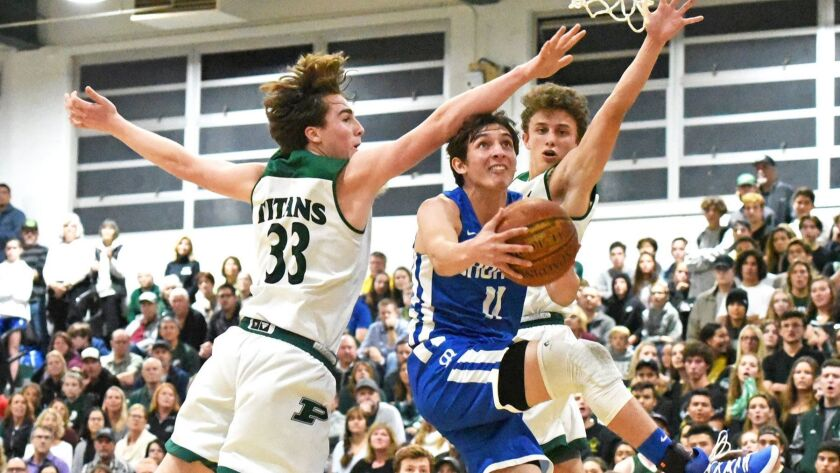 Rancho Bernardo's Chase Lyman drives with the ball, defended by Tanner Swindall and Adam Sevier, d