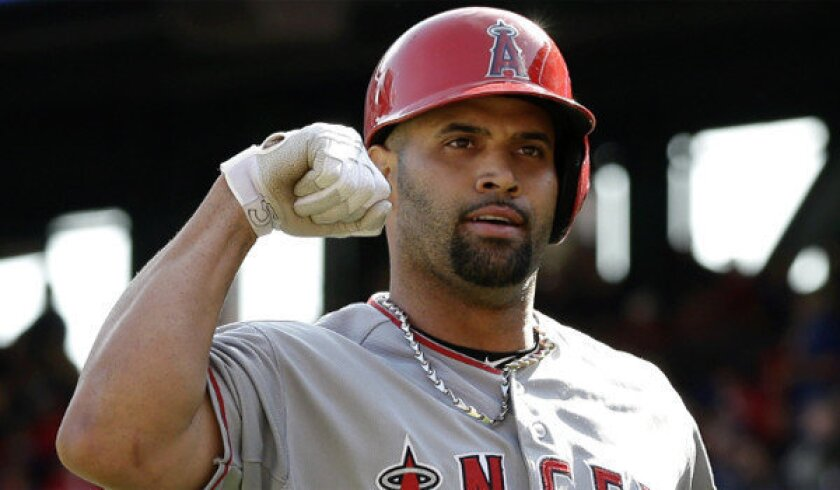 Albert Pujols has promised to take legal action against Jack Clark and his employer after the former major leaguer accused Pujols of using performance-enhancing drugs in a radio show.