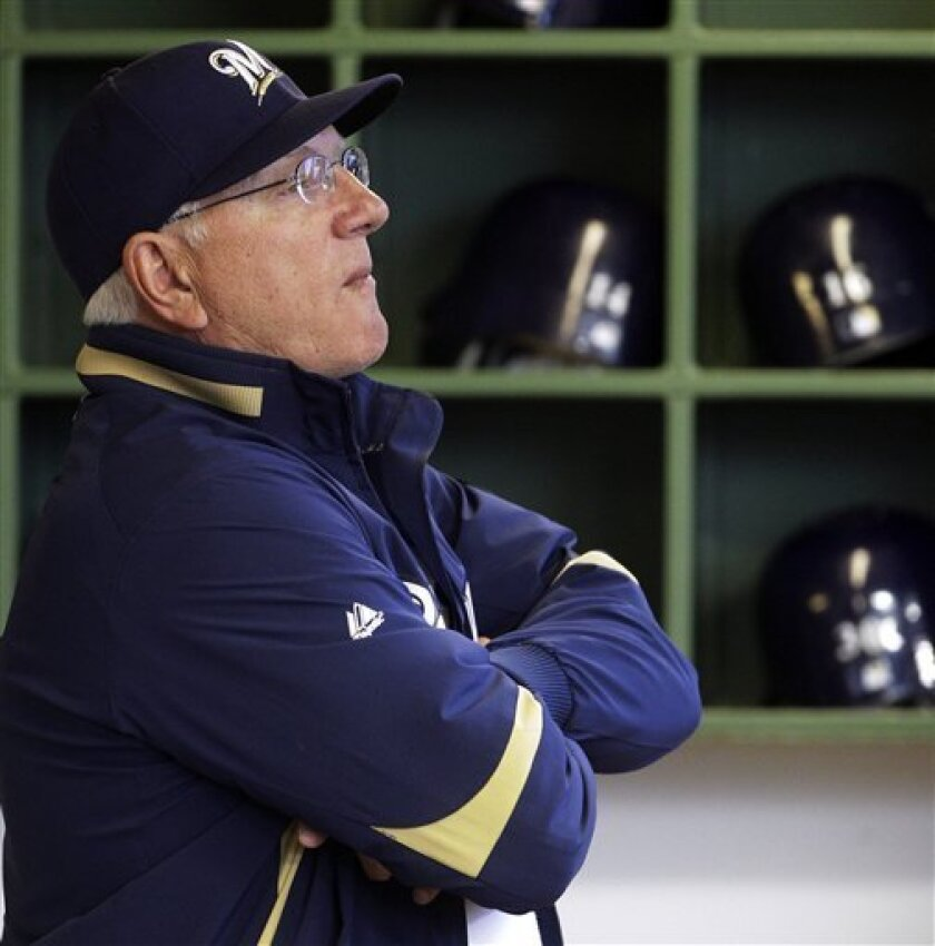 """FILE - This Sept. 26, 2010 file photo shows Milwaukee Brewers manager Ken Macha waiting for the start of the first inning of a baseball game against the Florida Marlins in Milwaukee. """"They're not going to pick up my option,"""" Macha told The Associated Press on Sunday night, Oct. 3, 2010, in response to the club's decision to let him go. (AP Photo/Morry Gash, File)"""