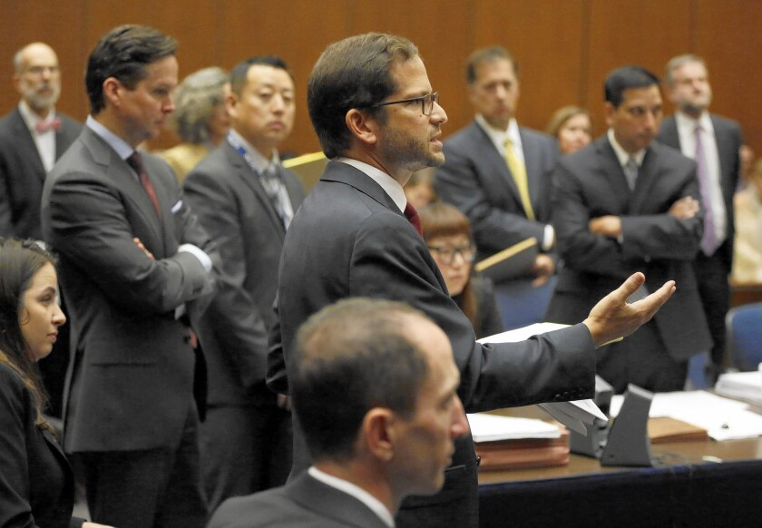 Attorney Benjamin N. Gluck addresses the court in Los Angeles on Sept. 25. Authorities said Oct. 6 that a surgeon accused of masterminding the scheme was still at large, despite an earlier announcement that he had been captured in Germany.