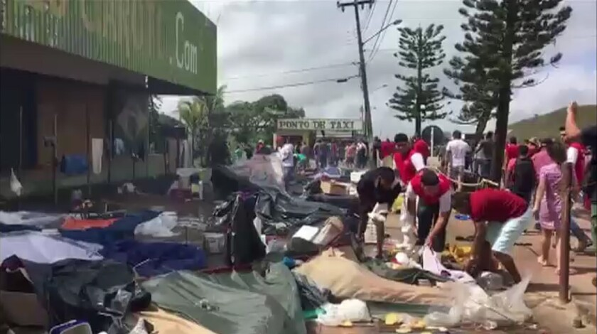 A still from an AFP video shows residents of the Brazilian border town of Pacaraima destroying belongings of Venezuelan immigrants during an attack on their makeshift camps Saturday.